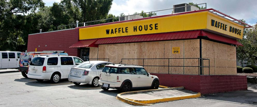 PHOTO: A still open Waffle House is seen with boarded up windows on Sept. 12, 2018, in preparation for Hurricane Florence.