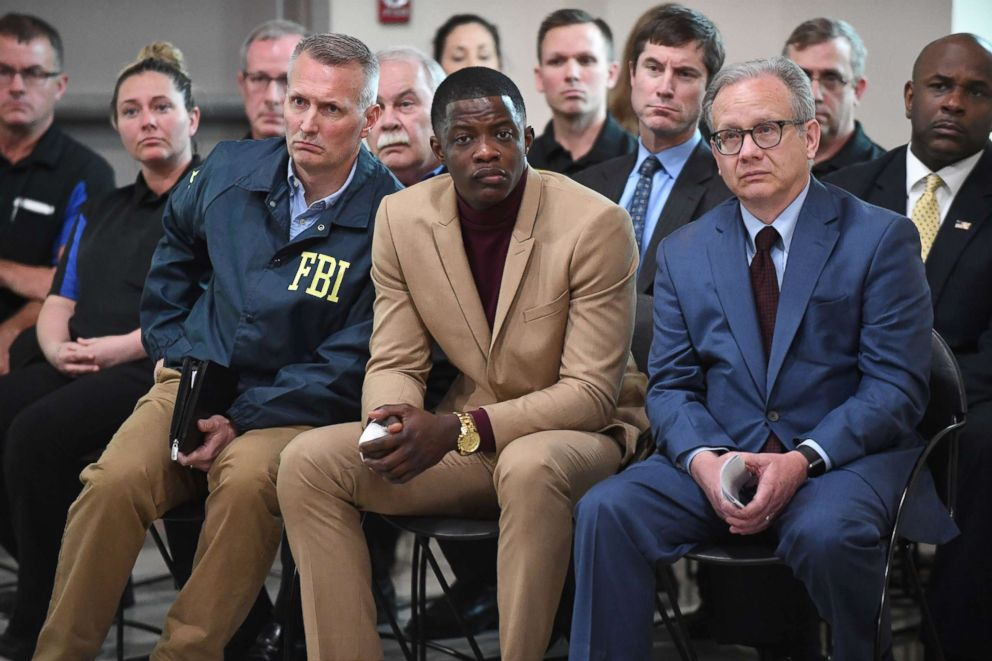 PHOTO: Waffle House patron James Shaw, Jr. attends a press conference with FBI Special Agent In Charge, Matthew Espenshade, left, and Metro Nashville Mayor David Briley, right, April 22, 2018 in Nashville, Tenn.