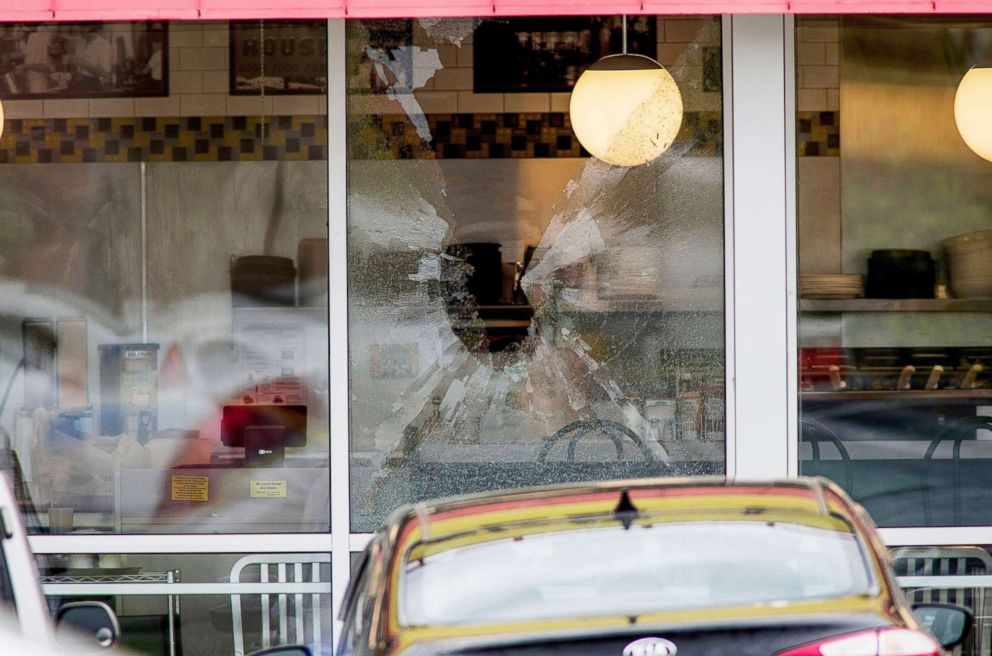 PHOTO: A shattered window at the scene of a shooting at a Waffle House Restaurant near Nashville, Tenn., April 22, 2018.