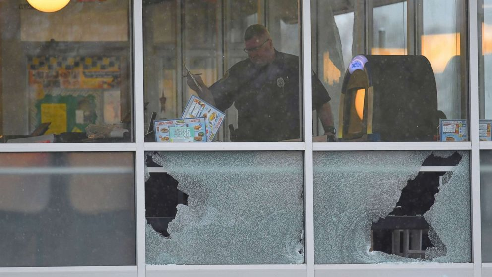 Metro Davidson County Police inspect the scene of a fatal shooting at a Waffle House restaurant near Nashville, Tennessee,  April 22, 2018.
