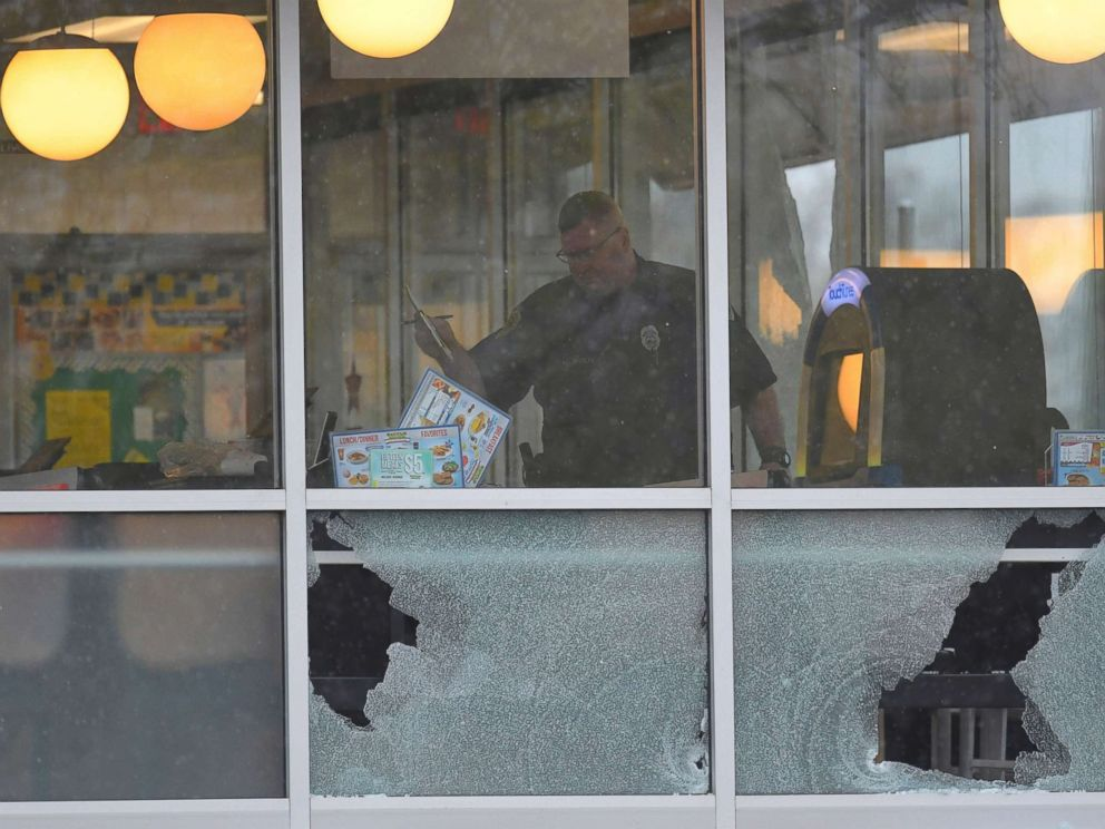 PHOTO: Metro Davidson County Police inspect the scene of a fatal shooting at a Waffle House restaurant near Nashville, Tennessee, April 22, 2018.