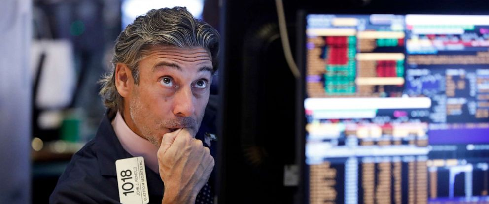 PHOTO: Trader John Romolo works on the floor of the New York Stock Exchange, Aug. 14, 2019.