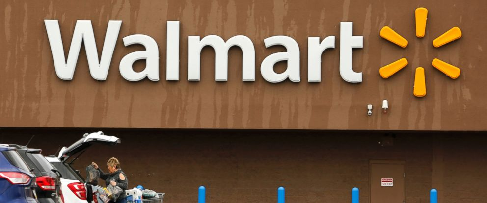 In this Feb. 22, 2018, file photo, a shopper loads her car after shopping at a Walmart store.