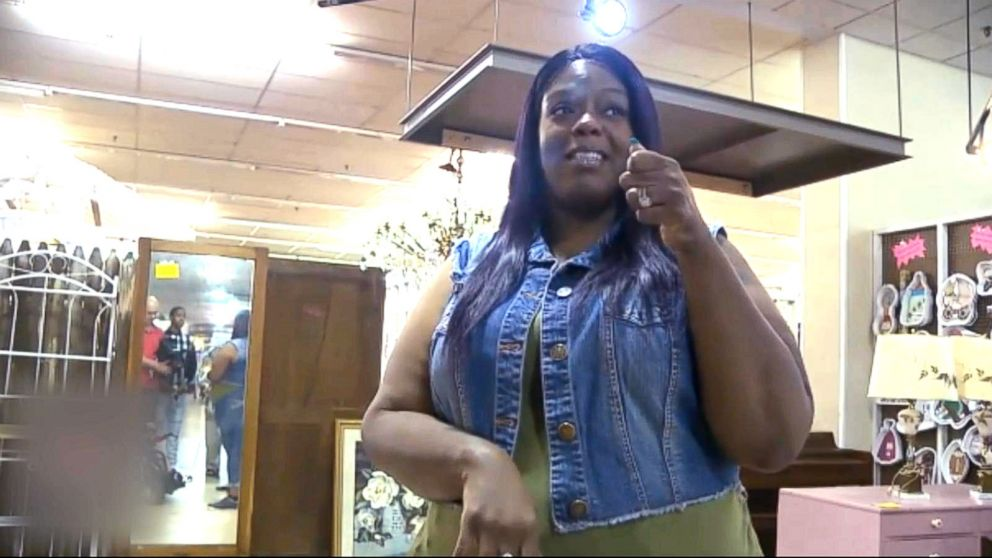 PHOTO: When Ebony Harris saw a woman, Angela Peters, in a wheelchair refused service from a nail salon near her work in Walmart, she decided to help.