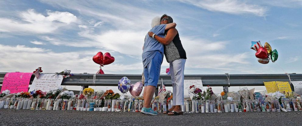 PHOTO: Emma Del Valle hugs Brenda Castaneda, right, while visiting the make-shift memorial outside the Walmart in El Paso, Texas, Aug. 5, 2019, following the mass shooting.
