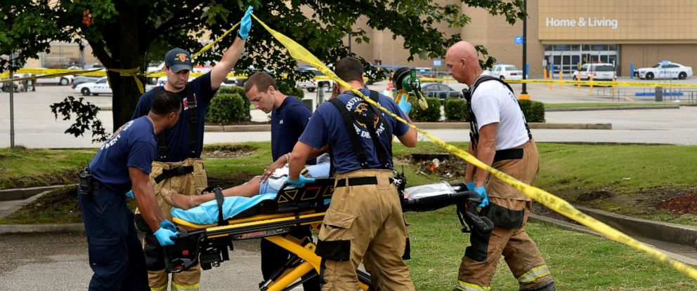 PHOTO: Paramedics offer medical attention after a shooting at a Walmart store Tuesday, July 30, 2019 in Southaven, Miss.