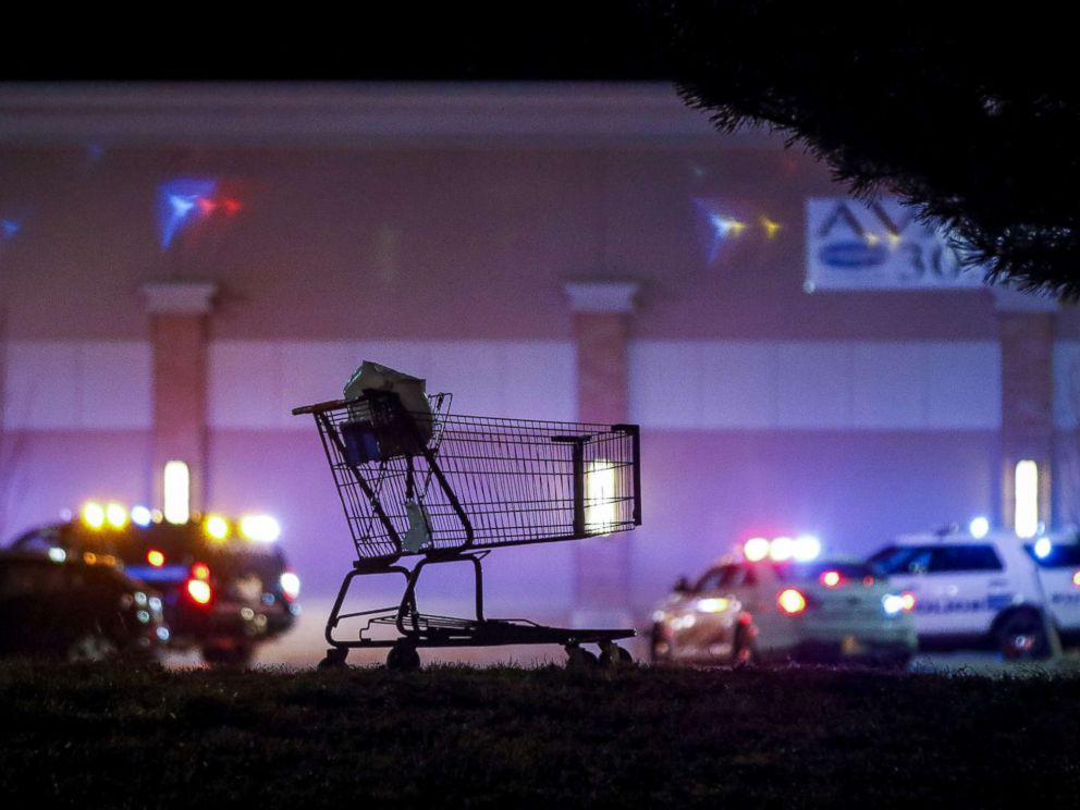 PHOTO: A shopping cart sits in the parking lot as police investigate the scene of a shooting at a Walmart store, Nov. 1, 2017 in Thornton, Colo.