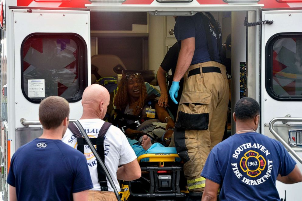 PHOTO: A Walmart employee receives medical attention after a shooting at the store, July 30, 2019, in Southaven, Miss.