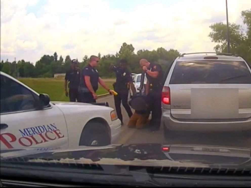 PHOTO: Meridian Police officer Daniel Starks pointed his stun gun at the suspect for a second time after shocking him in the shoulder while he was handcuffed on July 16.