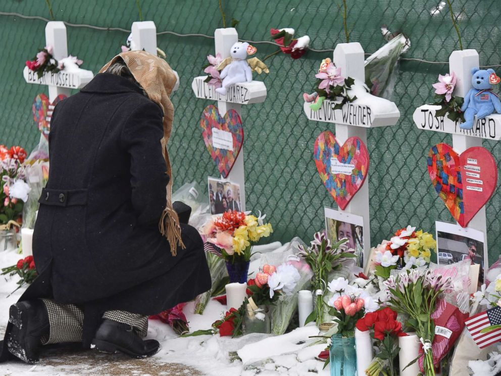 PHOTO: Mourners place a flower at the crosses outside of the Henry Pratt company in Aurora, Ill., Feb. 17, 2019, in memory of the five employees killed on Friday.