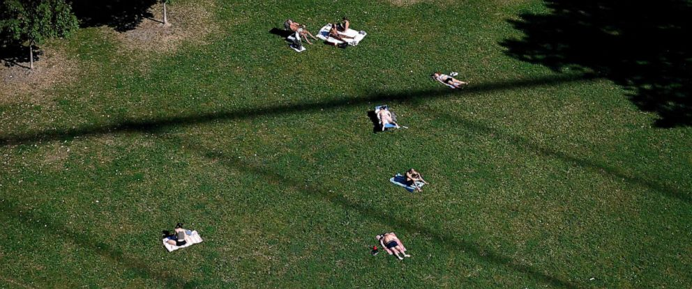 PHOTO: People soak in the sun in a park in late summer on Sept. 29, 2019, in New York City.