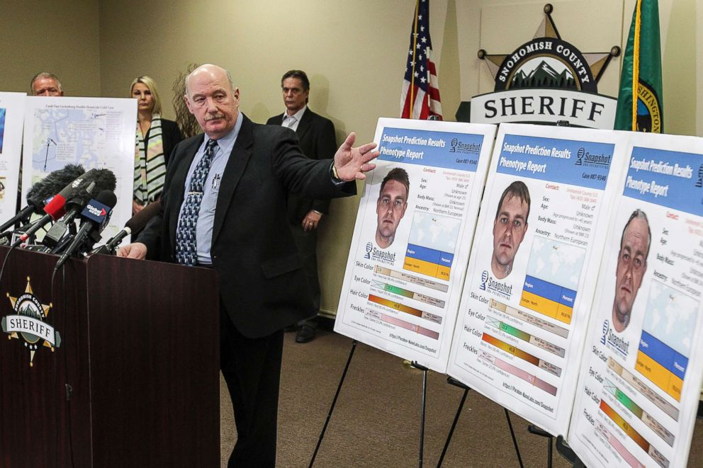 PHOTO: Detective Jim Scharf, left, presents new images rendered using phenotype technology of a potential suspect in the unsolved case of the 1987 double homicide of Jay Cook and Tanya Van Cuylenborg in Everett, Wash., on April 11, 2018.