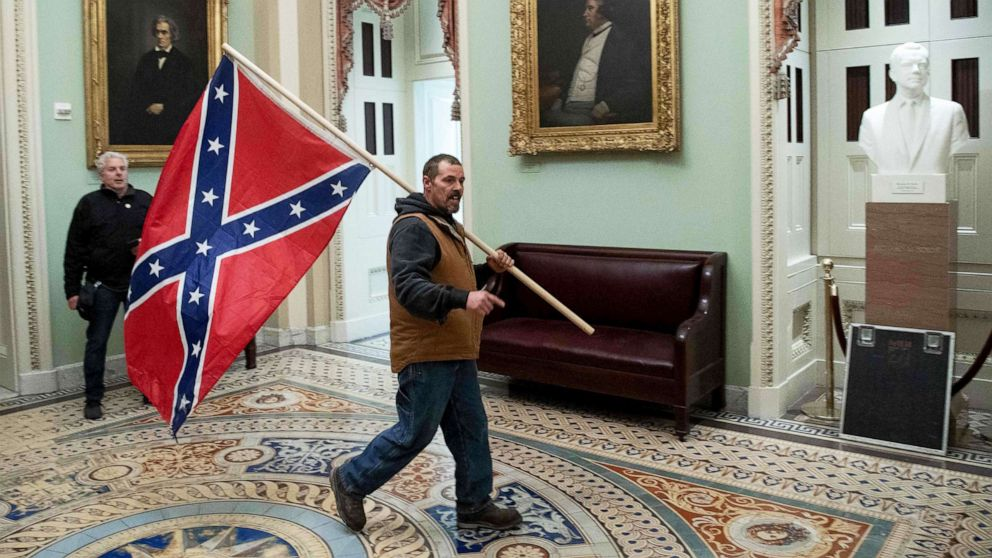 Man seen holding Confederate flag among latest Capitol siege arrests, authorities say
