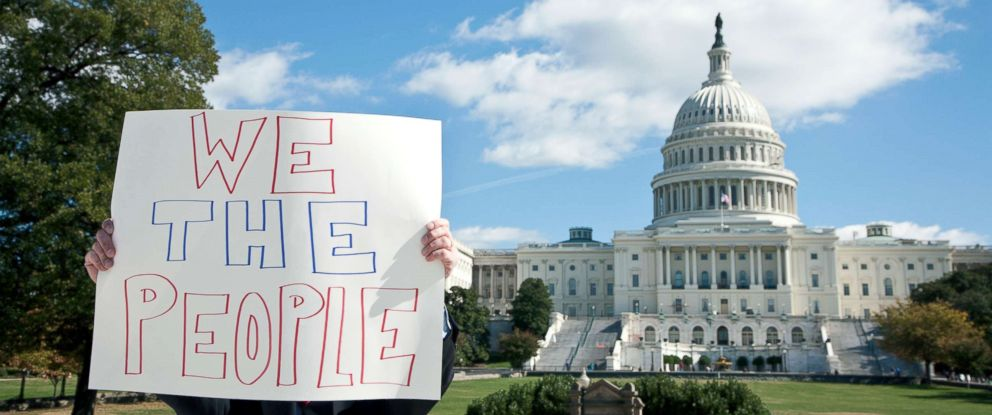 PHOTO: A protester holds a placard in front of the U.S. Capitol.