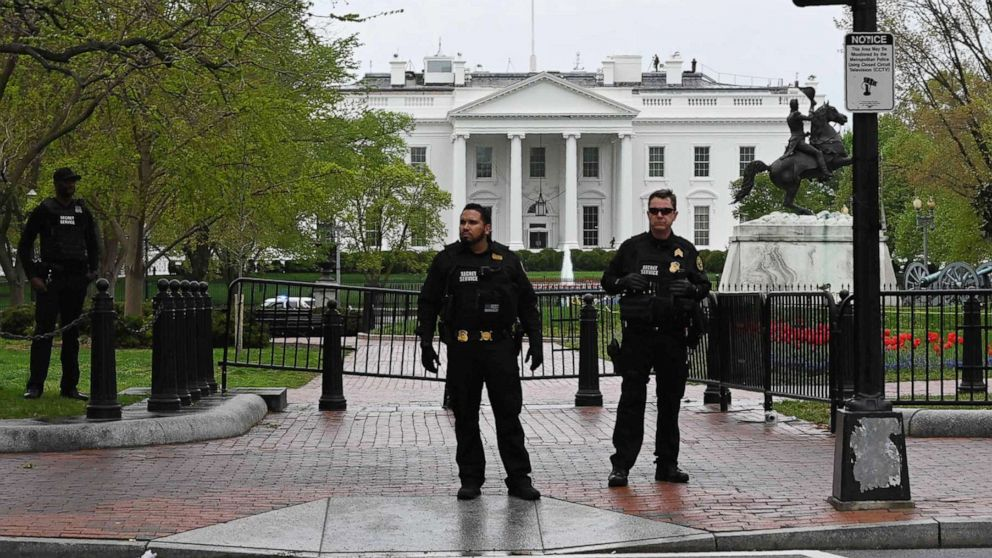 Police secure the perimeter of the White House after a man reportedly tried to set himself on fire outside the presidential mansion on April 12, 2019 in Washington.
