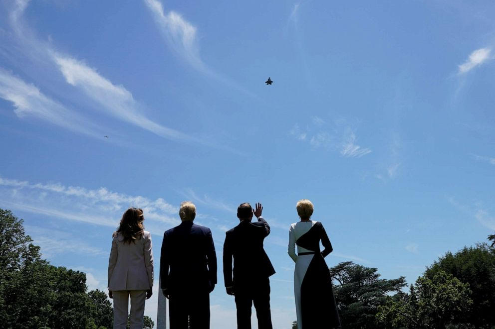 PHOTO: President Donald Trump and first lady Melania Trump stand with Polands President Andrzej Duda and his wife, Agata Kornhauser-Duda, as they watch an F-35 flyover outside the White House in Washington, June 12, 2019.