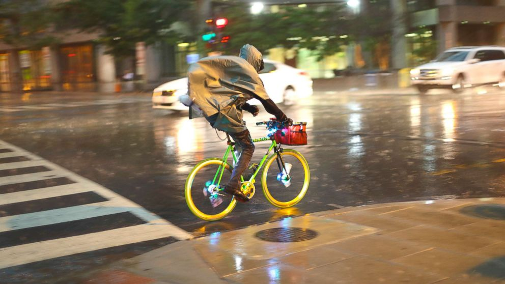 A bicyclist rides is heavy rainfall in downtown Washington, May 14, 2018.