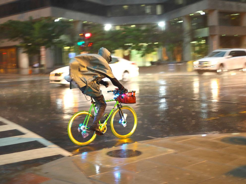 PHOTO: A bicyclist rides is heavy rainfall in downtown Washington, May 14, 2018.