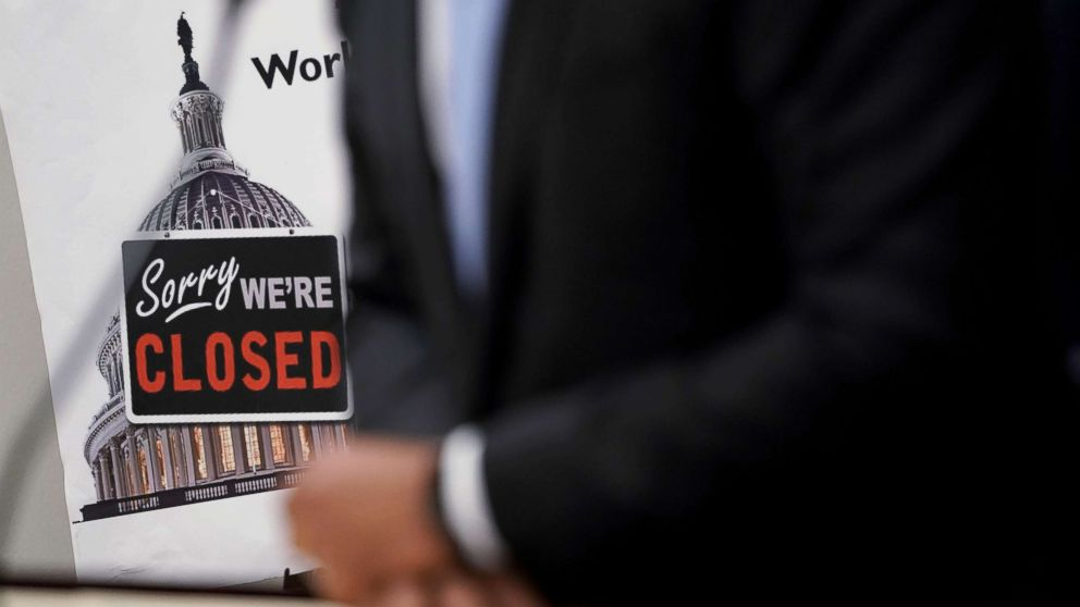 """A """"Closed"""" sign is seen during a news conference after a House Democratic Caucus meeting at the U.S. Capitol, Jan. 9, 2019, in Washington, D.C."""
