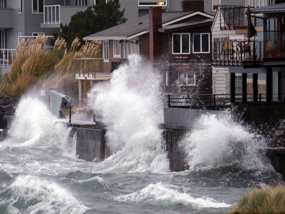 PHOTO: Waves send salt spray onto homes along Puget Sound in a windstorm, Nov. 13, 2017, in Seattle.