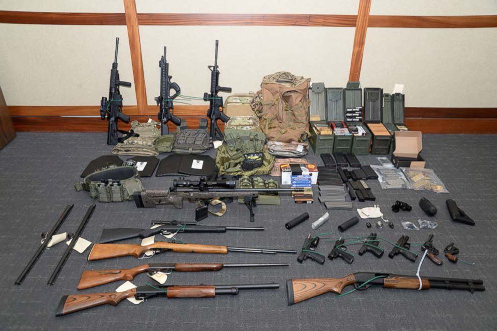A cache of guns and ammunition uncovered by U.S. federal investigators in the home of U.S. Coast Guard lieutenant Christopher Paul Hasson in Silver Spring, Maryland, U.S., is shown in the photo provided, Feb. 20, 2019.