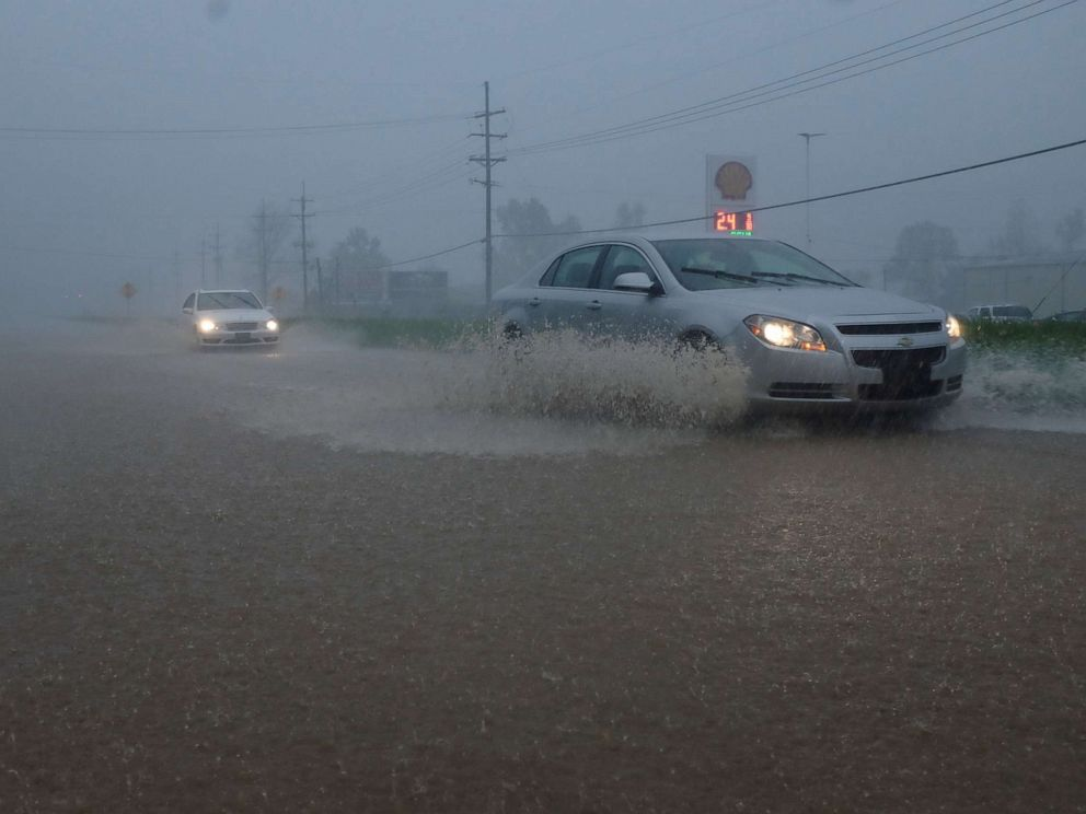 PHOTO: Vehicles travel through a flooded section of Highway 61 South following severe weather, April 13, 2019, in Vicksburg, Miss.