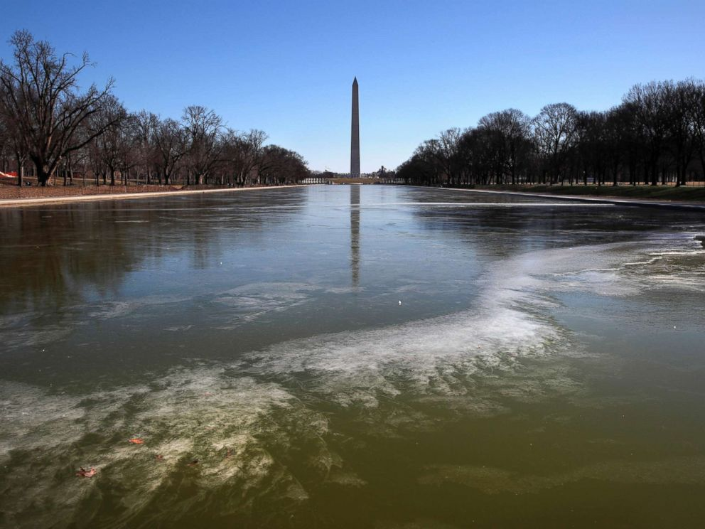 PHOTO: With the Washington Monument in the background, the reflecting pool by the Lincoln Memorial begins to turn to ice during frigid temperatures on the National Mall, Jan. 21, 2019, in Washington D.C.