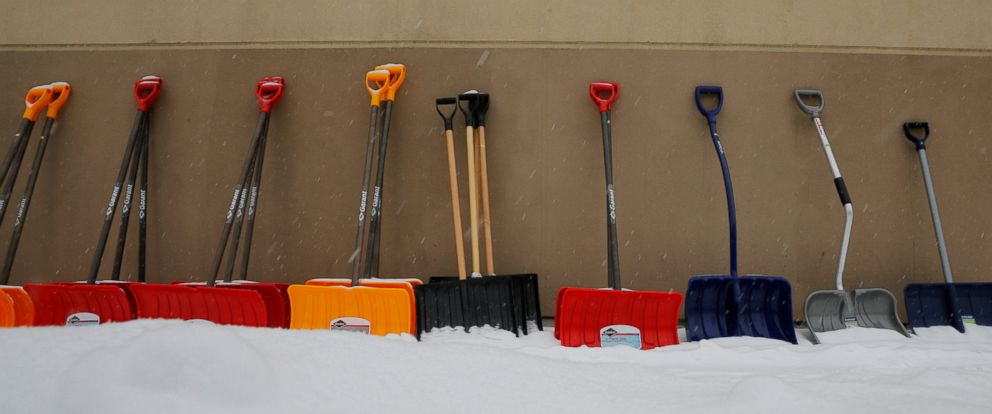 PHOTO: Snow shovels are displayed for sale during a winter snow storm in Arlington, Mass., March 2, 2019.