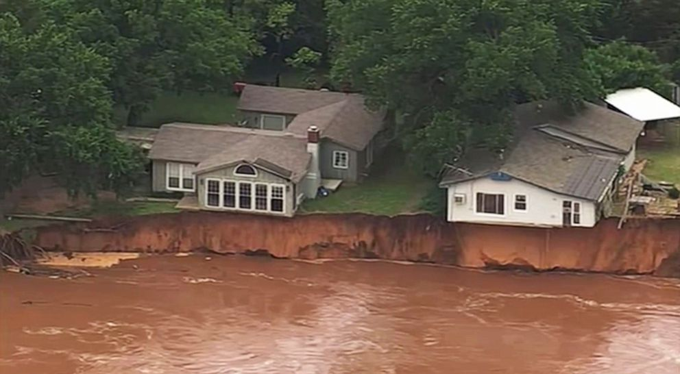 PHOTO: This image taken from video provided by KOCO-5 shows homes dangerously close to the Cimarron River, May 22, 2019, near Crescent, Oka.