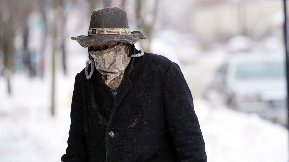 Marvin Hooks wears a face mask to protect him from the cold as he walks on North Street in Pittsfield, Mass., Jan. 21, 2019. Bitter cold and gusty winds swept across the eastern U.S. Monday with falling temperatures replacing the weekend's falling snow.