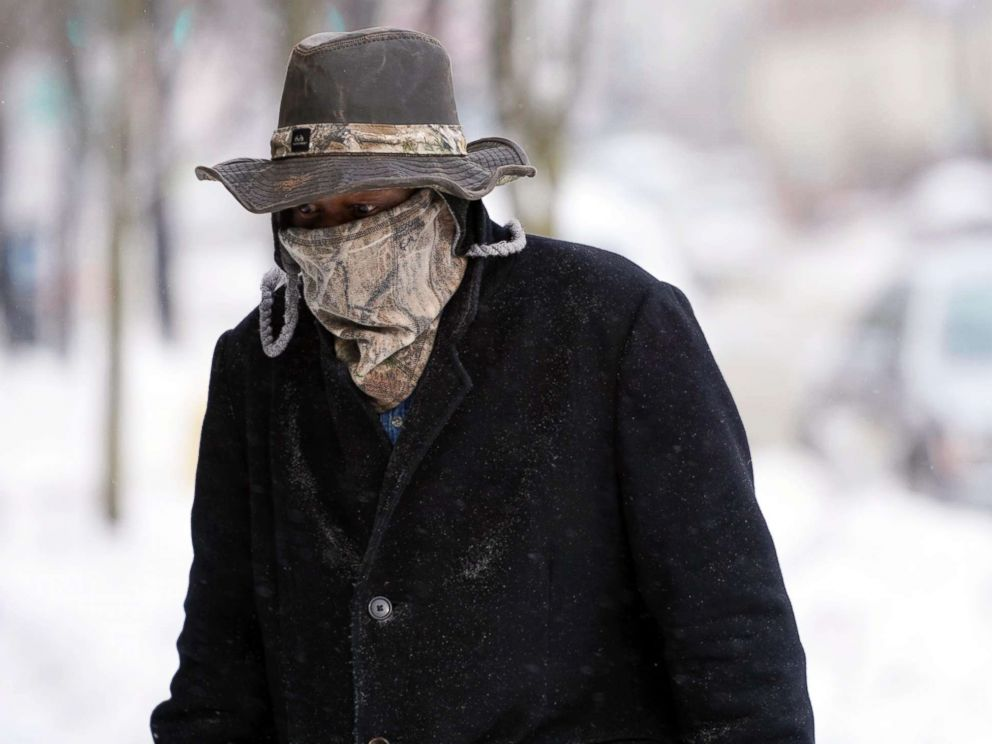 PHOTO: Marvin Hooks wears a face mask to protect him from the cold as he walks on North Street in Pittsfield, Mass., Jan. 21, 2019.