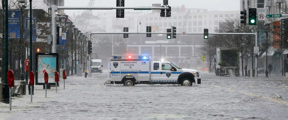 PHOTO: Water floods from Boston Harbor onto Seaport Boulevard in the Seaport district of Boston, March 2, 2018.
