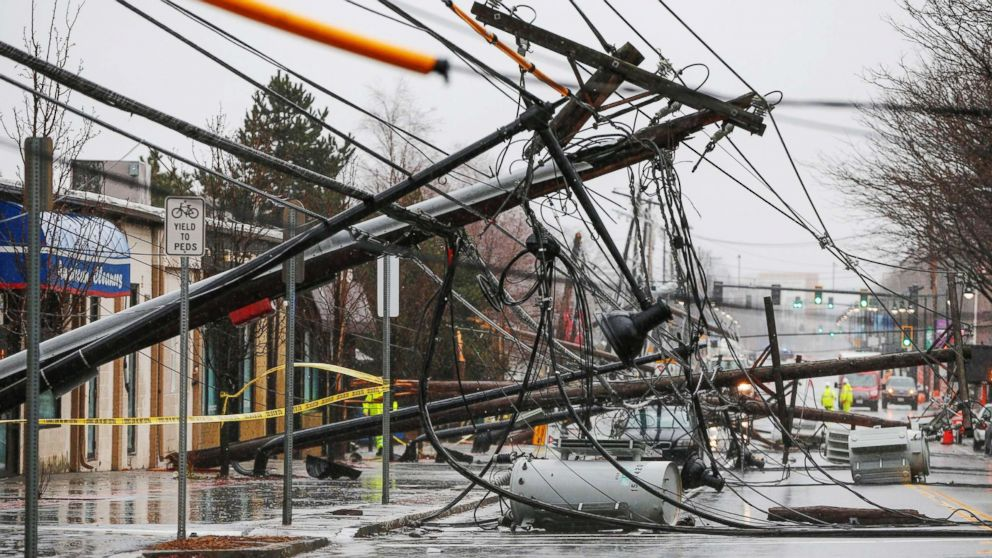 Wind knocks down power poles onto Arsenal Street in Watertown, Mass., March 2, 2018.
