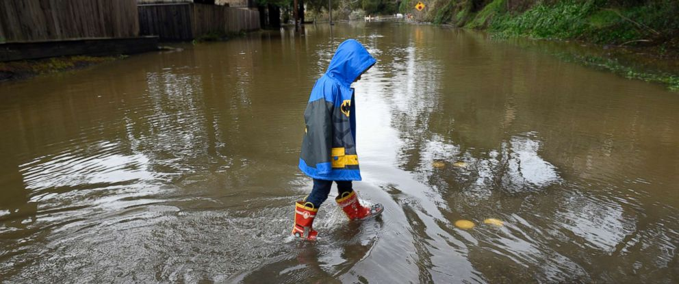 PHOTO: Chase Tyrie, 4, splashes in flood waters of the overflowed Russian River in Forestville, Calif., Feb. 27, 2019.