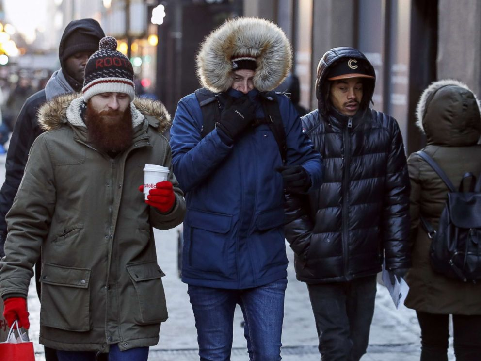PHOTO: Pedestrians walk along Michigan Avenue in Chicago, Dec. 27, 2017. Frigid temperatures are expected in the single digits in the midwest over the next few days.