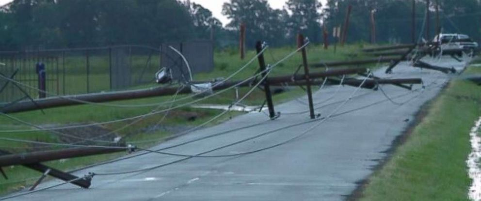 Strong winds in Arkansas knocked over telephone poles.
