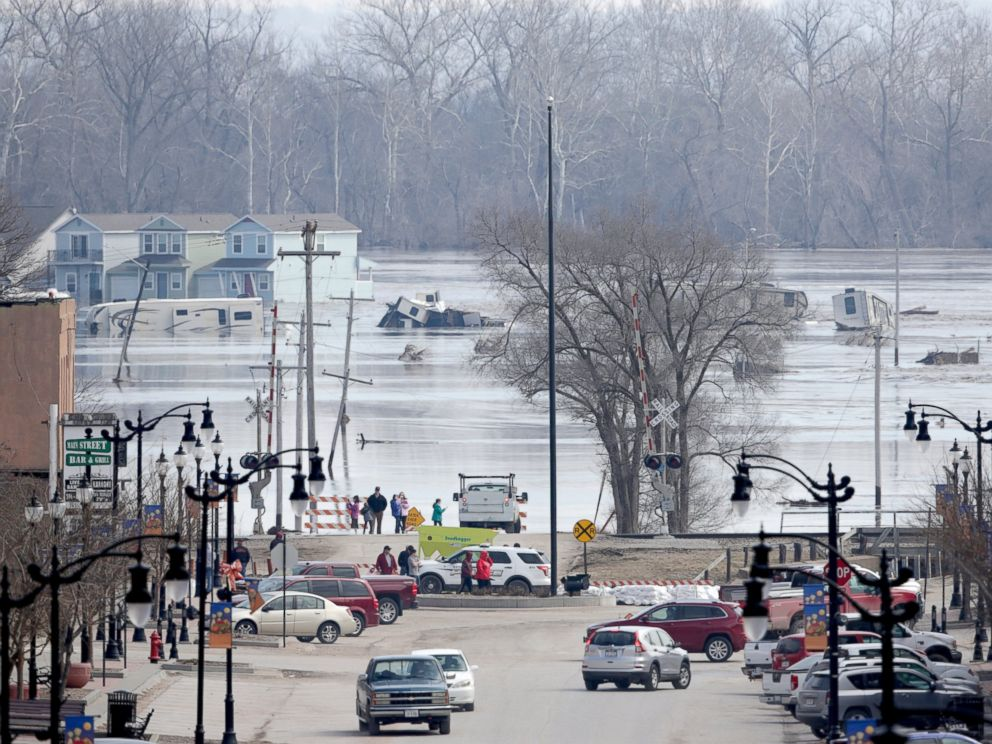 PHOTO: People view the rising waters from the Platte and Missouri rivers which flooded areas of Plattsmouth, Neb., Sunday, March 17, 2019.