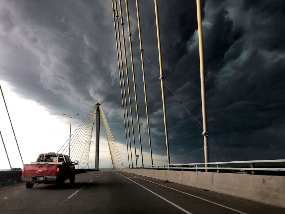 PHOTO: A truck drives east out of Alton, Ill., over the Clark Bridge as clouds from a severe warned thunderstorm roll in on Wednesday, July 17, 2019.