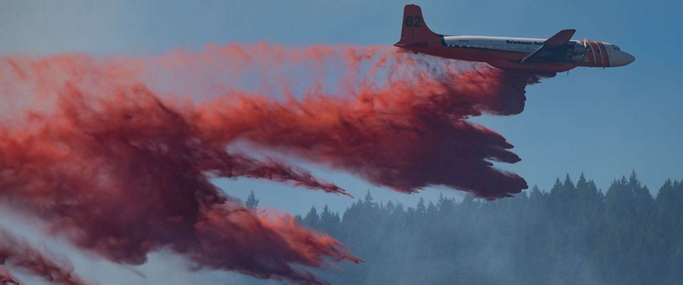 PHOTO: An air tanker makes a retardant drop on a fire burning on the east side of Mount Pisgah near Eugene, Ore., Thursday, Aug. 15, 2019.