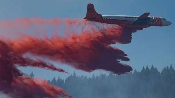 Wildfires feared out West as storms strike heartland