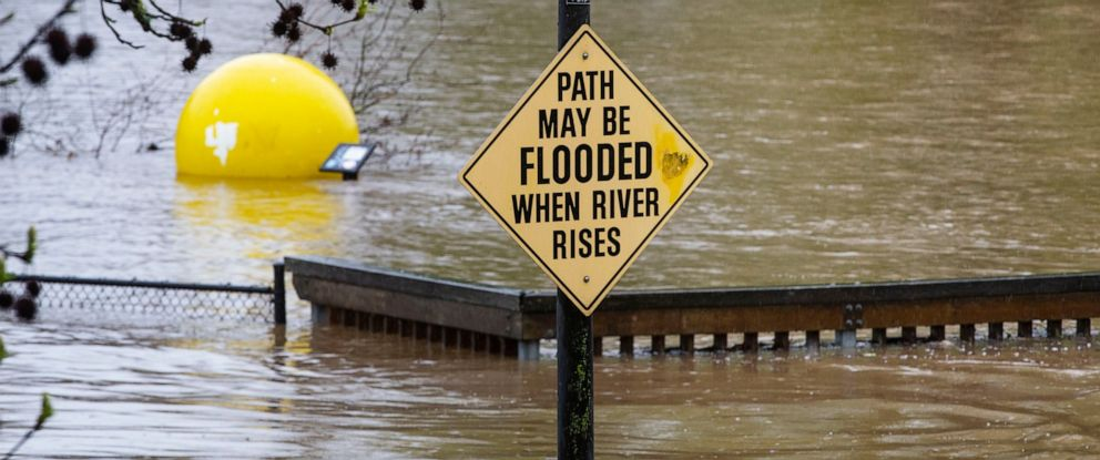 PHOTO: A sign warning of possible flood waters at the entrance to Alton Baker Park in Eugene, Oregon, proves to be an understatement on Monday, April 8, 2019.