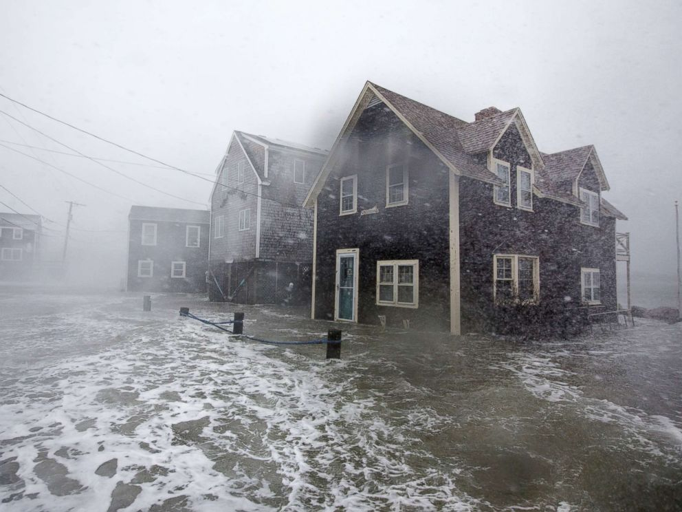 PHOTO: Lighthouse Rd. begins to flood during a large coastal storm March 2, 2018 in Scituate, Mass.