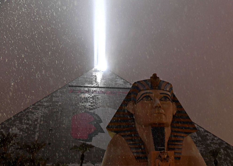 PHOTO: The light on top of Luxor Hotel and Casino illuminates snow falling during a winter storm, Feb. 20, 2019, in Las Vegas.