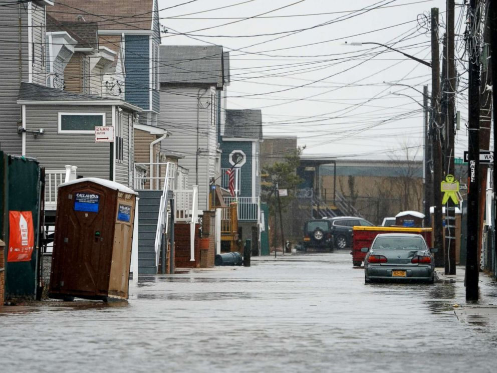PHOTO: A car sits in high water on a flooded street during rain and high winds, March 2, 2018, in the Broad Channel section of Queens in New York.