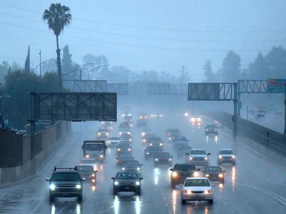 PHOTO: Commuters drive under heavy rainfall in Los Angeles, March 21, 2018. A slow-moving storm, billed as an atmospheric river began unleashing rain across southern California.