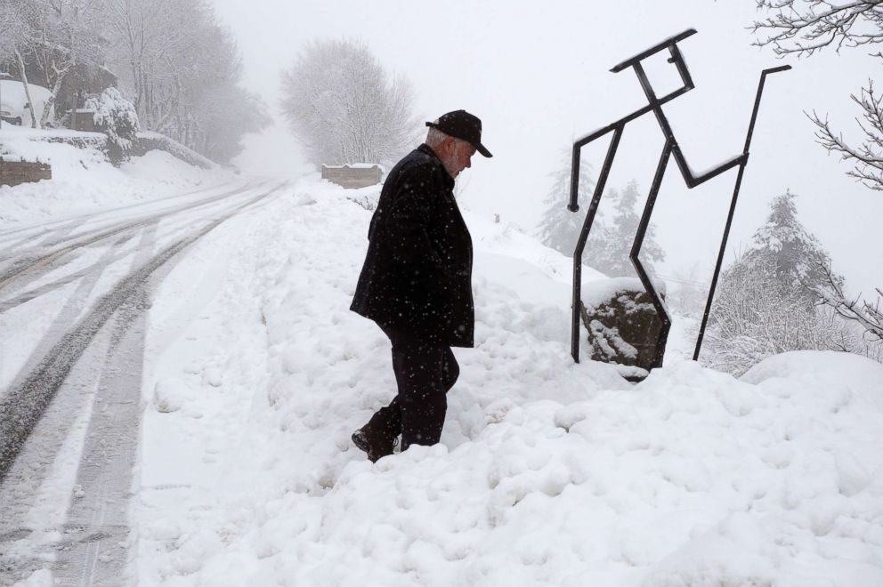 PHOTO: A man walks through the snow in Pedrafita do Cebreiro in Lugo, Spain, March 5, 2018.