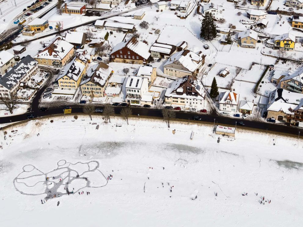 PHOTO: A picture taken with a drone shows people walking on ice paths carved through the snow on the frozen lake Lac de Joux after a series of cold days in Le Pont, Western Switzerland   , March 4, 2018.