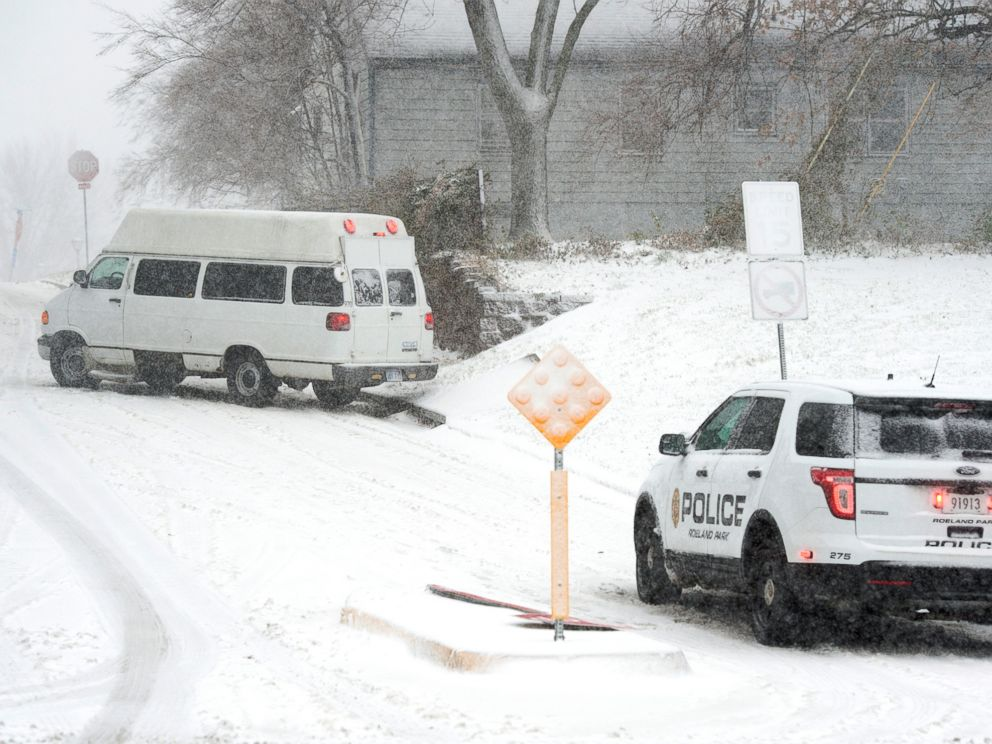 Police from Roeland Park, Kan., watched as the driver of a van tried to a navigate a slick street Sunday, Nov. 25, 2018, that hit the Kansas City area.