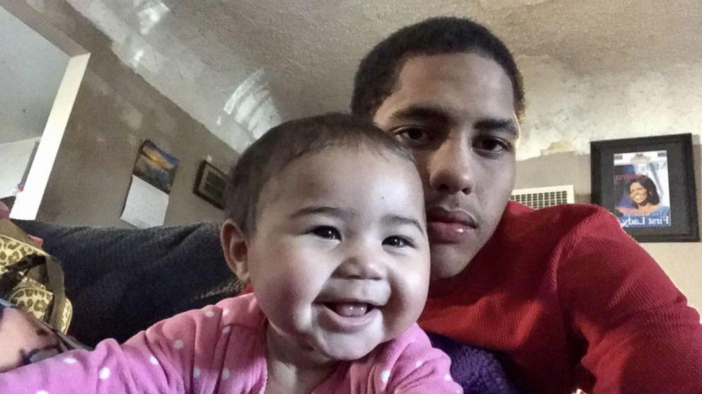 PHOTO: Closeup photo of Anthony AJ Weber, 16, taking a selfie with his newborn daughter Violet.
