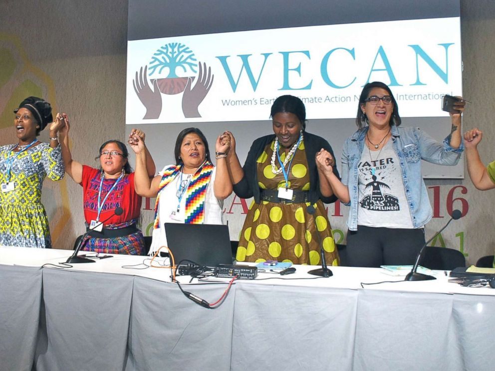 PHOTO: Global women leaders stand together after presenting at a WECAN event inside the United Nations Climate Talks.